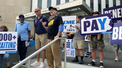Activists gather in downtown Pittsburgh to call for unemployment benefits